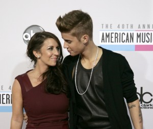 Justin Bieber arrives with his mother at the 40th American Music Awards in Los Angeles