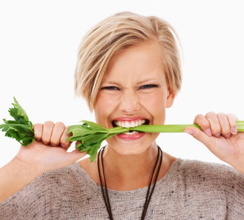women-biting-veggies