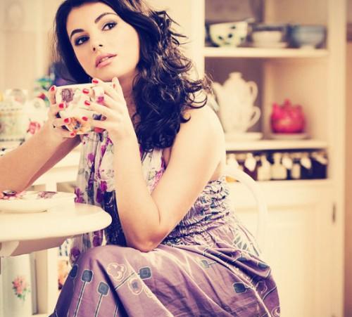 Woman-in-Purple-Dress-Drinking-Tea
