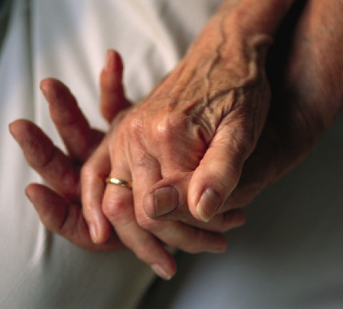 Lincoln, Nebraska. An elderly couple's entwined hands.