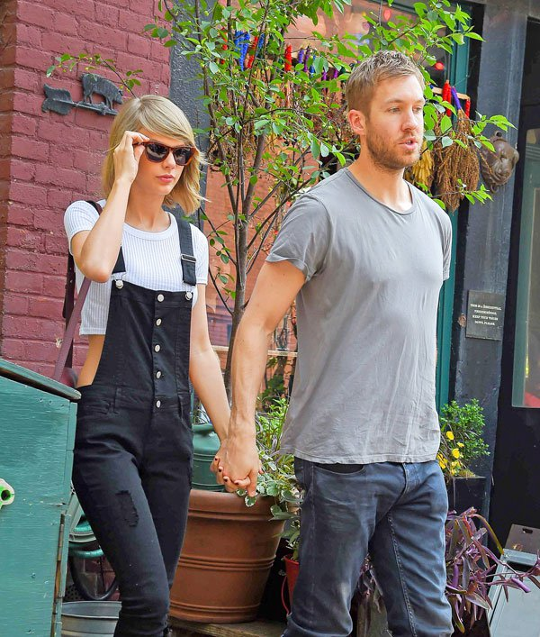 Cute Couple; Taylor Swift and Calvin Harris spotted holding hands while leaving The Spotted Pig Restaurant, after having lunch with Taylor's best male friend, Ed Sheeran, in the West Village in New York City. Pictured: Taylor Swift and Calvin Harris Ref: SPL1039395 280515 Picture by: Splash News Splash News and Pictures Los Angeles:310-821-2666 New York:212-619-2666 London:870-934-2666 photodesk@splashnews.com