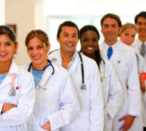 Group of doctors in a row at a hospital